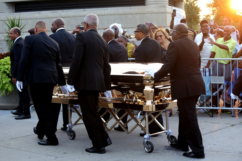 Aretha Franklin's gold casket arrives at the Charles H. Wright Museum of African American History in Detroit on Tuesday.