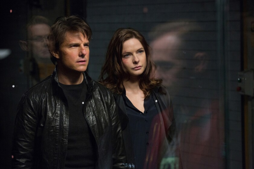 """In this image released by Paramount Pictures, Tom Cruise and Rebecca Ferguson appear in a scene from """"Mission: Impossible - Rogue Nation."""""""