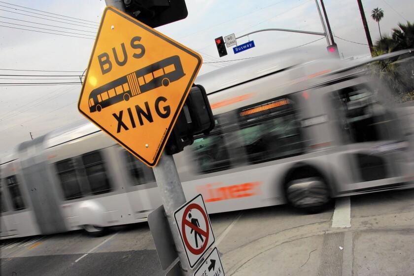 A Metro Orange Line bus travels across Kester Avenue in Van Nuys.