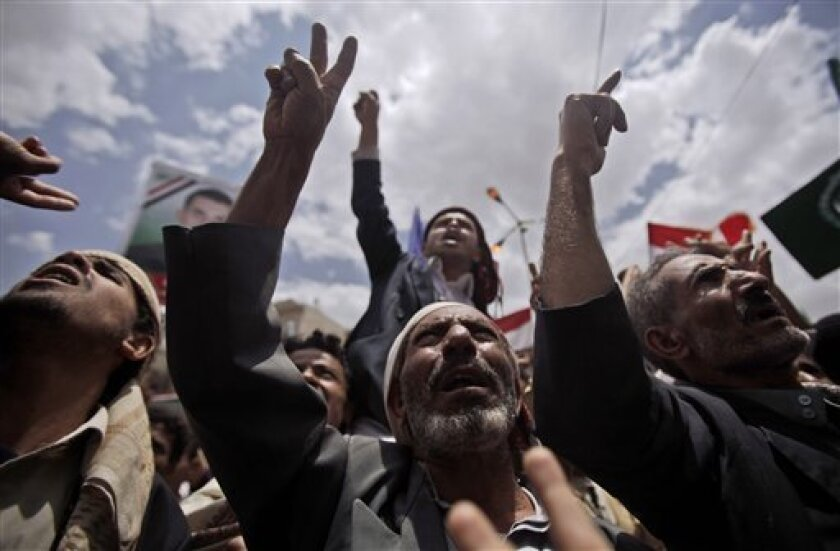 Anti-government protestors gesture during a demonstration demanding the resignation of Yemeni President Ali Abdullah Saleh, in Sanaa, Yemen, Sunday, April 10, 2011. Government forces shot bullets and tear gas at demonstrators in Yemen's capital and another city on Saturday as longtime President Ali Abdullah Saleh resisted a diplomatic push for the resignation that hundreds of thousands of his own people were demanding in the streets. (AP Photo/Muhammed Muheisen)