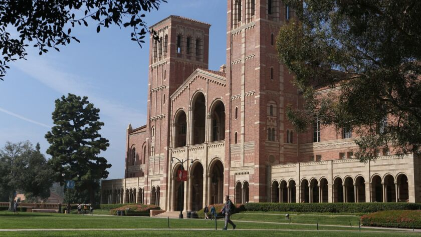 LOS ANGELES CA. MARCH 1, 2016: Students walk by Royce Hall at UCLA on on March 1, 2016 (Glenn Koeni