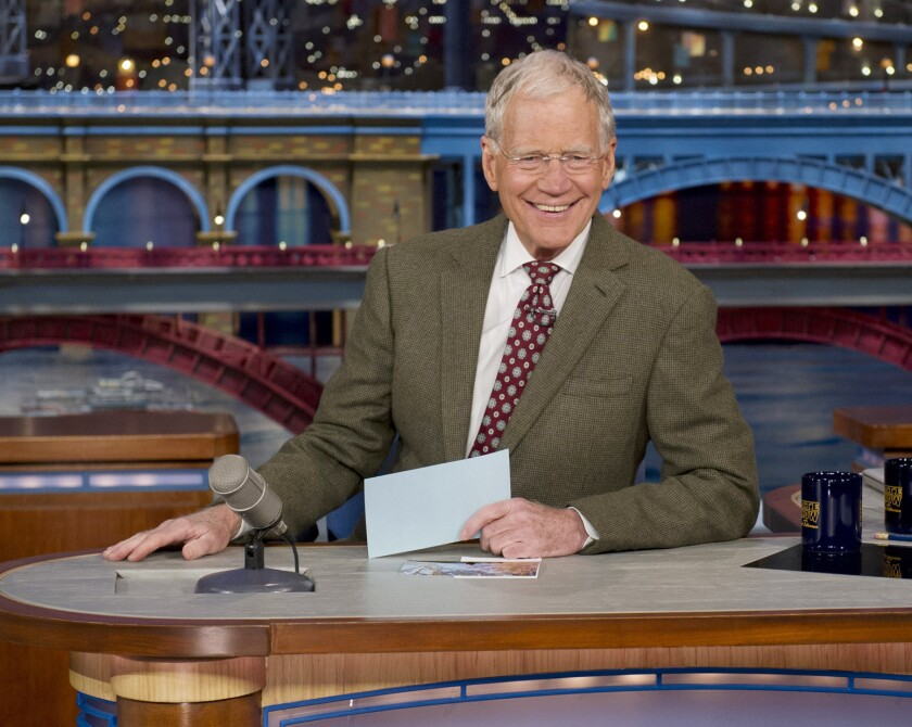 """David Letterman sits at his """"Late Show"""" desk during the broadcast in which he announced his retirement."""