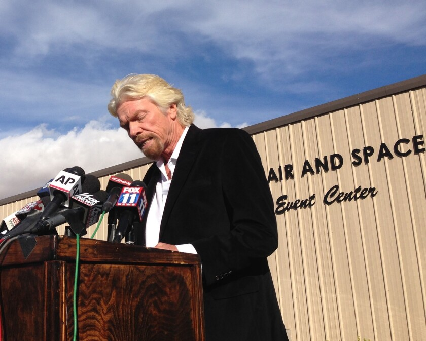 Billionaire Virgin Galactic founder Richard Branson speaks to reporters in Mojave on Saturday, a day after the crash of his company's prototype space tourism rocket.