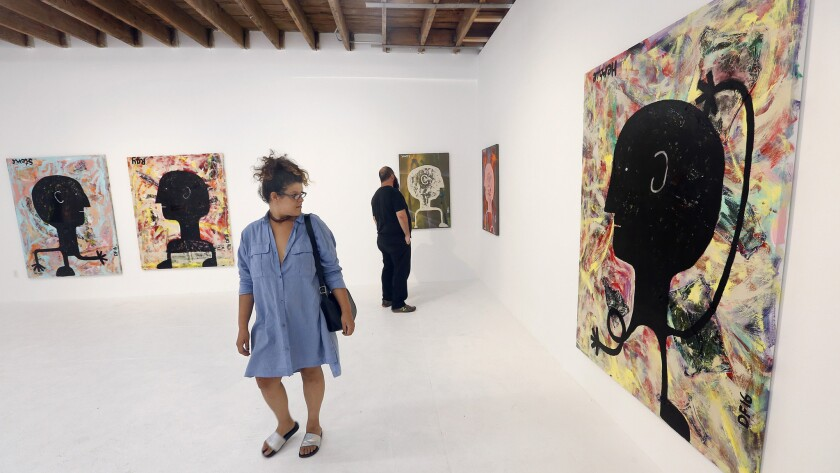 Visitors view art at Chimento Contemporary gallery in Boyle Heights.