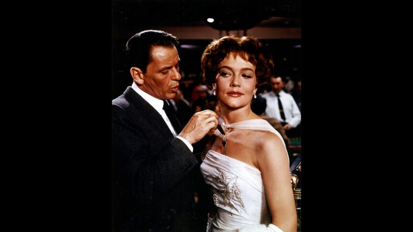 "Frank Sinatra and Patrice Wymore in ""Ocean's 11,"" the 1960 film inspired by a story written by George Clayton Johnson."
