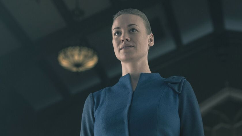 "This image released by Hulu shows Yvonne Strahovski in a scene from ""The Handmaid's Tale."" On Thursd"