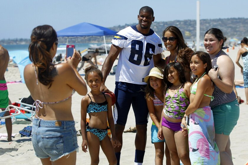 San Diego Chargers reciever Vincent Brown takes photo with fans in Mission Beach as the team went throughout the county making surprise visits.