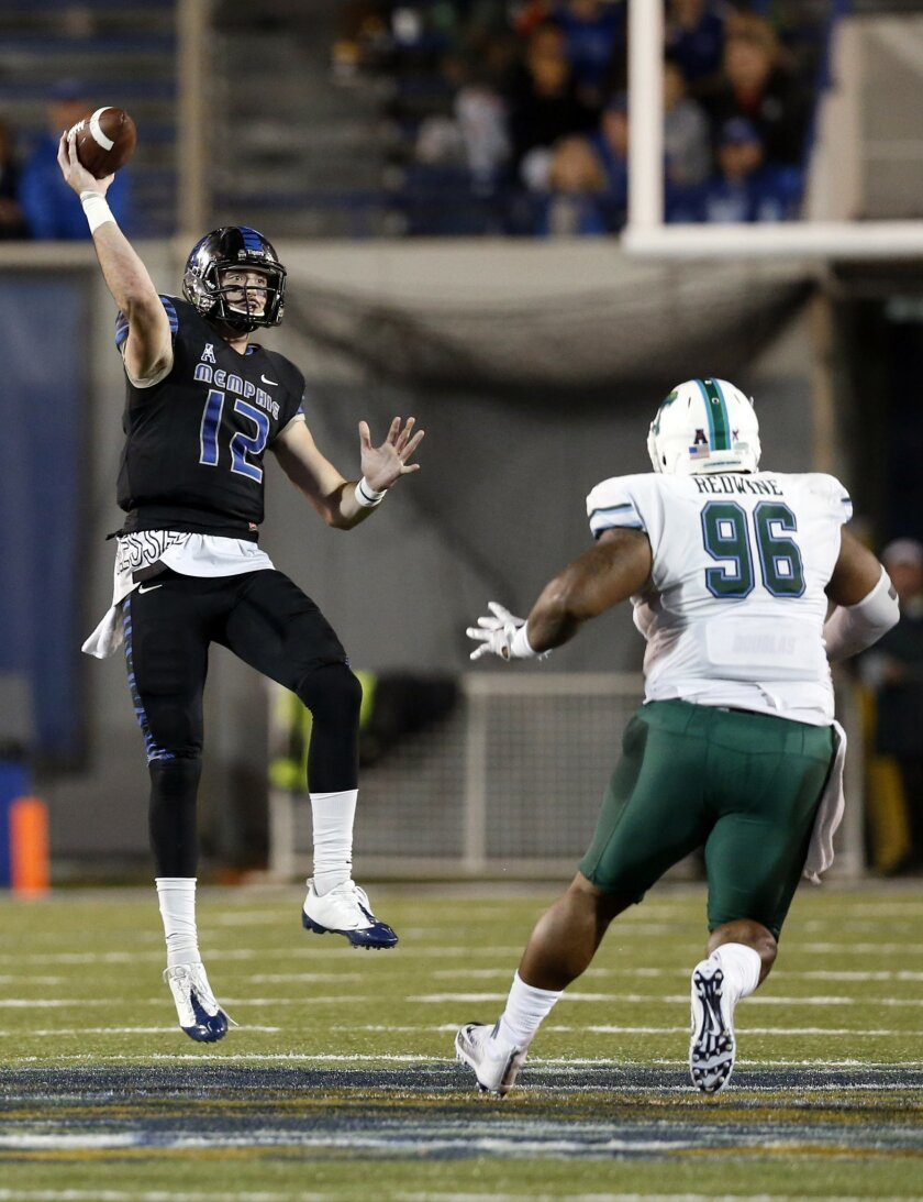 Memphis quarterback Paxton Lynch (12) passes over Tulane defensive tackle Corey Redwine (96) in the second half of an NCAA college football game in Memphis, Tenn., Saturday, Oct. 31, 2015. No. 16 Memphis won 41-13. (AP Photo/Rogelio V. Solis)