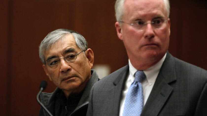 Samuel Leung, left, with his lawyer, Daniel V. Nixon, in Los Angeles Superior Court on Friday. Leung was charged with making illegal campaign donations in connection with an apartment project he was seeking to develop.