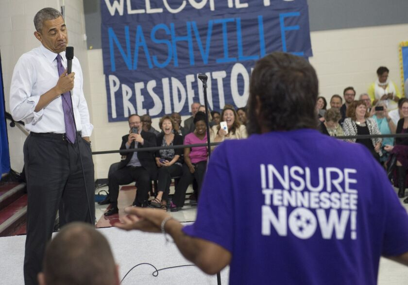 President Obama takes a question about the Affordable Care Act at a Tennessee forum in July.