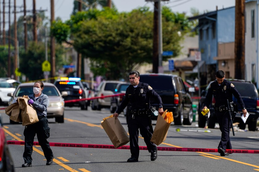 Law enforcement officers at scene of a shooting at the 5800 block of Orange Avenue in Long Beach.