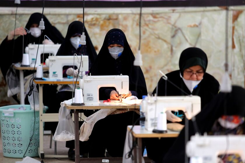 Iranians sew protective masks