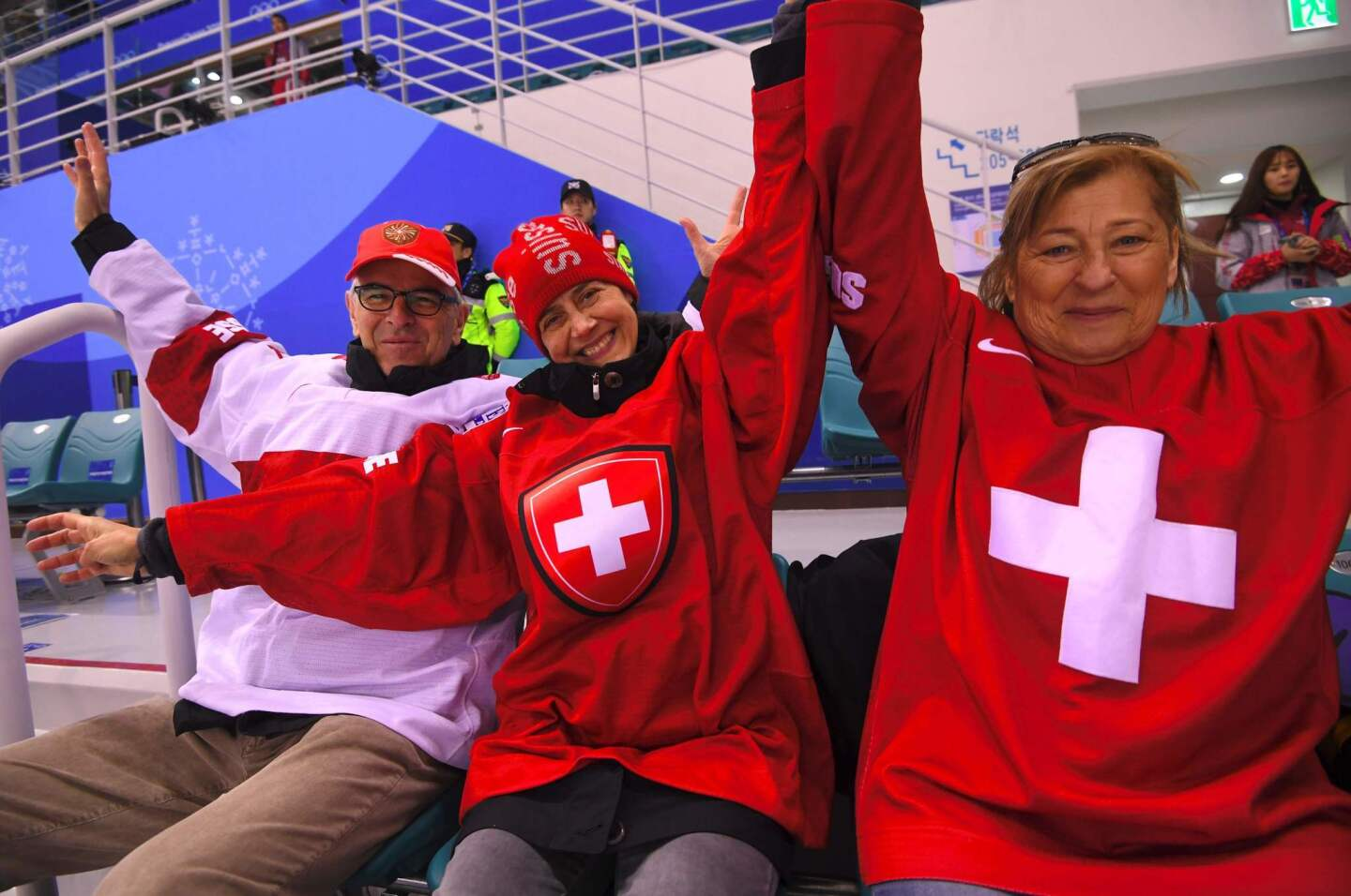 Switzerland's fans cheer in the women's quarter-final ice hockey match between the Olympic Athletes from Russia and Switzerland during the Pyeongchang 2018 Winter Olympic Games at the Kwandong Hockey Centre in Gangneung on February 17, 2018. / AFP PHOTO / Jung Yeon-jeJUNG YEON-JE/AFP/Getty Images ** OUTS - ELSENT, FPG, CM - OUTS * NM, PH, VA if sourced by CT, LA or MoD **