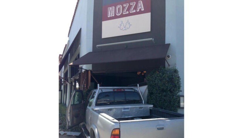 A truck crashed into Osteria Mozza's front door, temporarily closing the restaurant.
