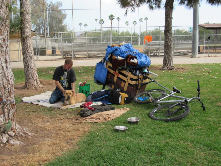 The city of El Cajon continues to partner with groups to assist its homeless population, including persons and their animals who spend some of their days at Wells Park.