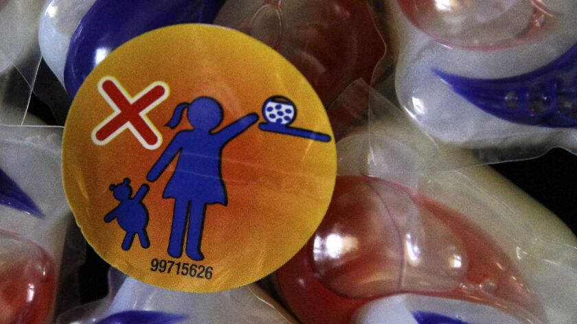 """A 2012 file photo shows a warning label attached to a package of Tide laundry detergent packets. The San Diego-based Snopes.com website ran a story verifying that teens were eating the pods as part of the """"Tide Pod Challenge."""""""