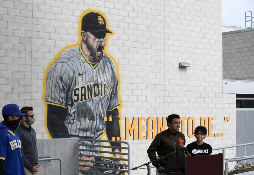 Muralists Paul Jimenez (in jacket) and Signe Ditona speak at unveiling of mural of Joe Musgrove at Grossmont High.