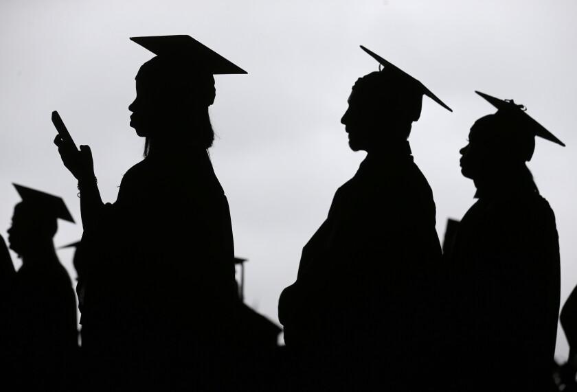 New graduates line up