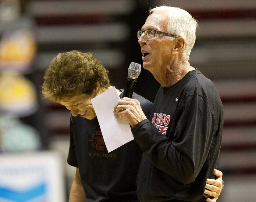Aztec head coaches Beth Burns (left) and Steve Fisher share a laugh as they introduce their teams to the fans .during the first basketball practice for both the men's and women's team at SDSU.