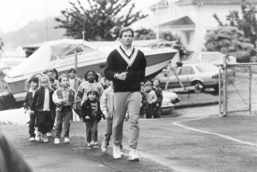 """Arnold Schwarzenegger spoofs his macho image in the hit kiddie comedy """"Kindergarten Cop."""""""
