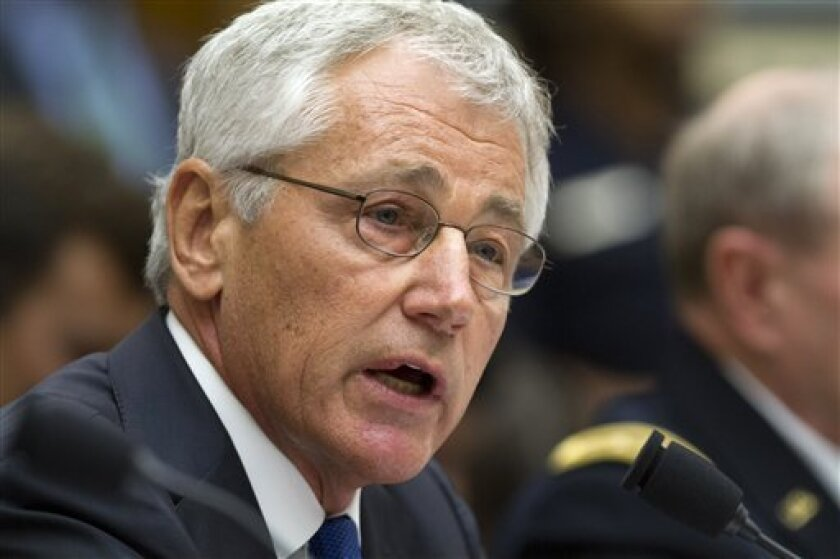 Defense Secretary Chuck Hagel testifies on Capitol Hill in Washington, Tuesday, Sept. 10, 2013, before the House Armed Services Committee hearing on the proposed authorization to use military force in Syria. (AP Photo/Jacquelyn Martin)
