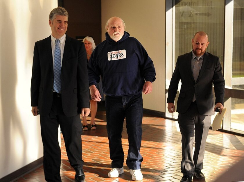Michael Hanline leaves the Ventura County Jail on Monday with attorney Alex Simpson, right, and California Innocence Project director Justin Brooks in Ventura, Calif. on Monday, Nov. 24, 2014. The 69-year-old man convicted of murder 34 years ago was freed after prosecutors told a judge they're no l