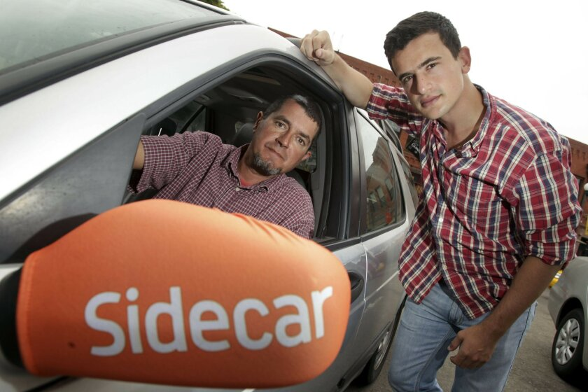 Sidecar driver Angelo Filippatos, left, and rider Harry Birnbaum in downtown San Diego. The Sidecar for-profit ridesharing app connects people who need rides with those willing to drive them. Photo by Hayne Palmour IV U-T San Diego