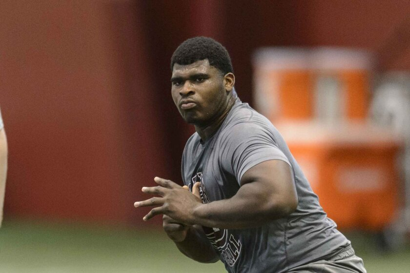 Former Alabama lineman D.J. Fluker, right, worked out for an NFL official during Alabama's second pro day for NFL scouts, Thursday, April 11, 2013, in Tuscaloosa, Ala.