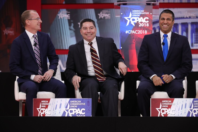 Federal Communication Commission members, from left, Brendan Carr, Michael O'Rielly and Chairman Ajit Pai particiate in a discussion during the Conservative Political Action Conference at the Gaylord National Resort and Convention Center Feb. 23, 2018 in National Harbor, Md.