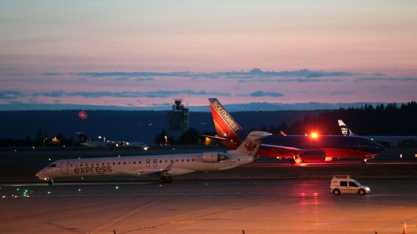 Planes sit on the tarmac at Sea-Tac International Airport after service was halted after an Alaska A