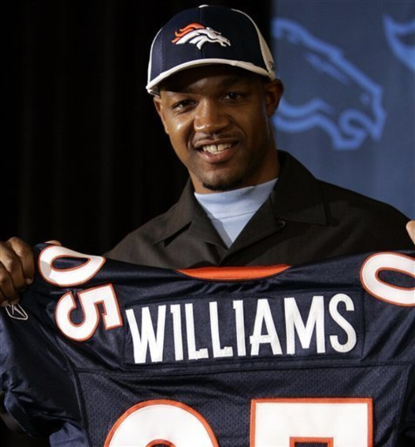 FILE - In this April 24, 2005 file photo, Oklahoma State cornerback Darrent Williams smiles as he holds a Broncos' jersey bearing his name a news conference as the team's headquarters in Denver. A witness too afraid to testify against the man accused of killing Denver Broncos cornerback Darrent Williams has changed his mind after a night in jail. (AP Photo/Ed Andrieski, file)