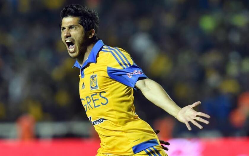Damian Álvarez de Tigres celebra la anotación de un gol ante Águilas del América. EFE/Archivo