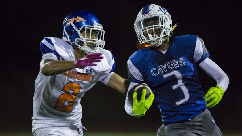 San Diego running back Jayden Wickware fights off Clairemont's Donovan Fitzgerald on a rush in the second quarter.