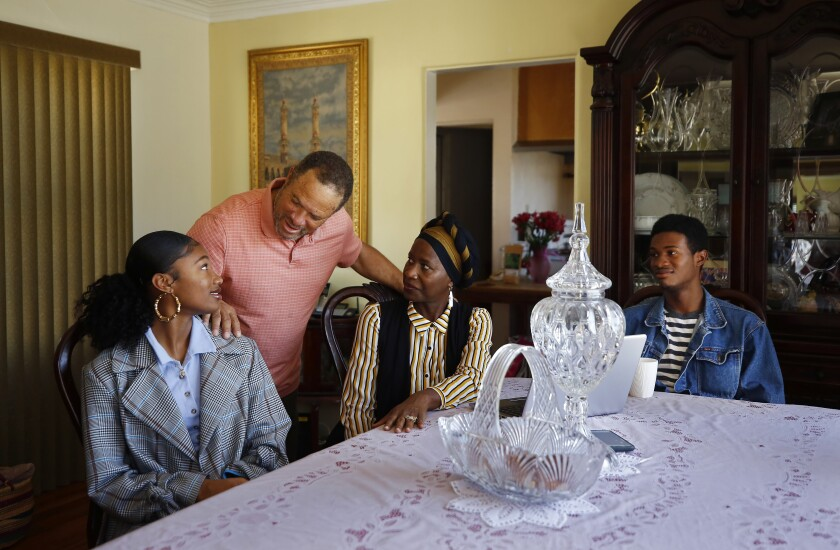 Abdur-Rahim Hameed is preparing to observe the month of Ramadan in his home with his family because of the ban on public gatherings. Shown here are Hameed, daughter Aiyanna, 17, left, wife Janiece, and son Mustafah, 22, on Wednesday.