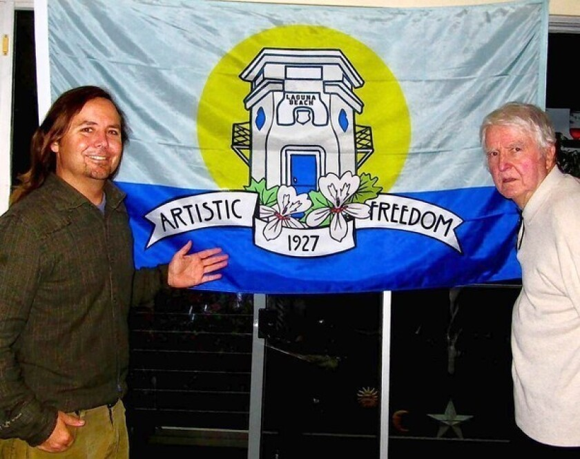 Chad Cooper, left, was prompted by his father, Lance, to create a flag for Laguna Beach.