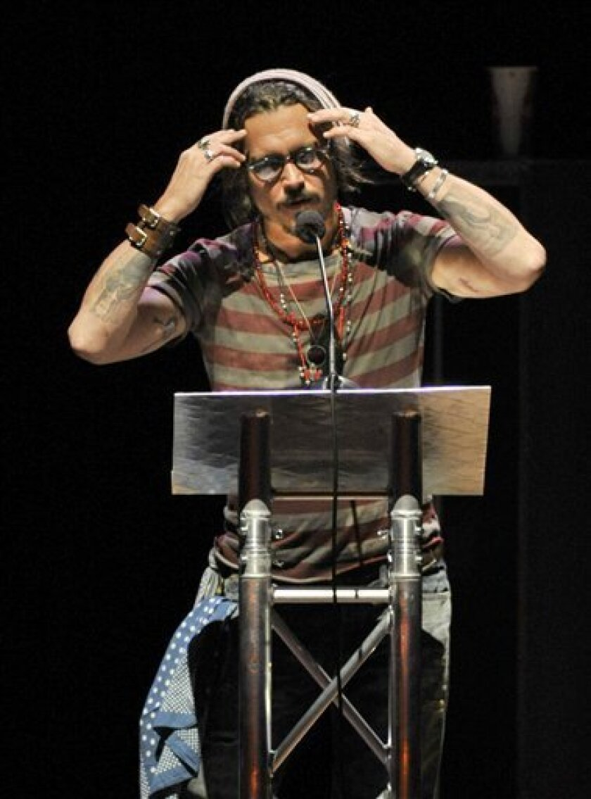 """FILE - In this Saturday Aug. 28, 2010 file picture, actor Johnny Depp addresses the crowd at the """"Voices for Justice"""" concert in Little Rock, Ark. in support of three Arkansas men convicted of the 1993 deaths of three West Memphis boys. Supporters of the """"West Memphis Three"""" argue there were two sets of victims from the May 5, 1993 crime: the three murdered 8-year-olds and Damien Echols, Jason Baldwin and Jessie Misskelley, the then-teenagers who defenders claim were wrongly convicted in the deaths. (AP Photo/Brian Chilson, File)"""