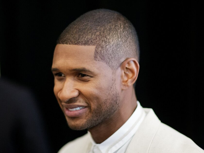 R&B singer Usher attends the 15th anniversary celebration of his New Look Foundation, Thursday, July 31, 2014, in Atlanta. Usher felt overwhelmed by the amount of supporters at his New Look Foundation's 15th year anniversary luncheon. Legendary boxer Sugar Ray Leonard, director Kenny Leon and produ