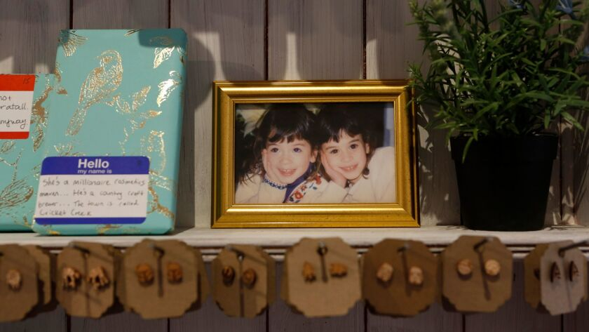 Family photos sit framed around the Ripped Bodice bookstore in Culver City.