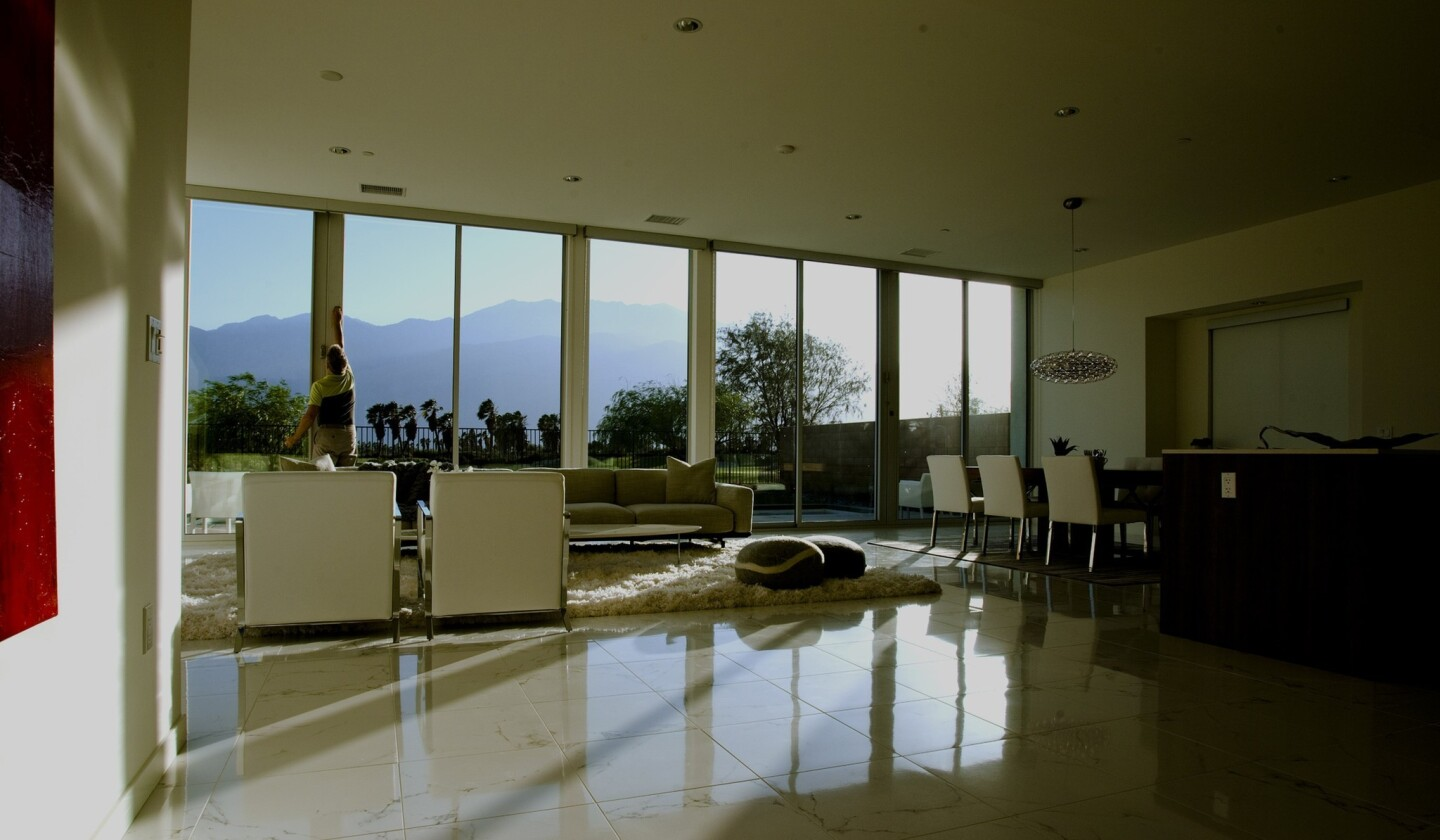 One of the Escena floor plans features an open kitchen that flows freely to a dining area and living room with 10-foot-tall floor-to-ceiling glass overlooking the San Jacinto Mountains.