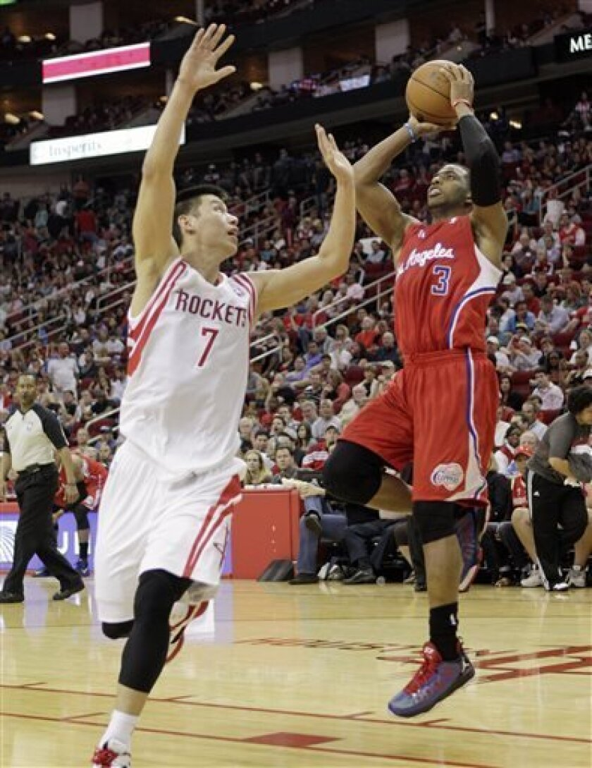 Los Angeles Clippers guard Chris Paul (3) shoots over Houston Rockets guard Jeremy Lin (7) during the first half of an NBA basketball game Saturday, March 30, 2013 in Houston. (AP Photo/Bob Levey)
