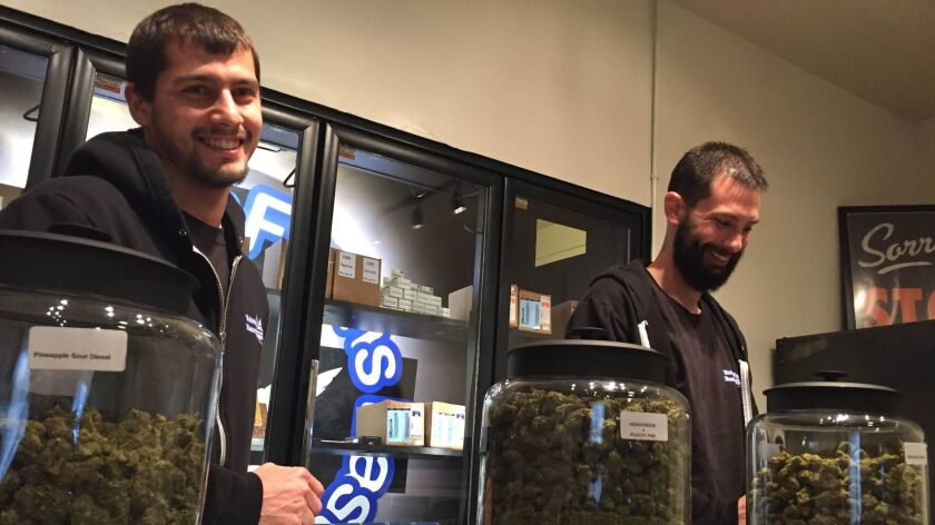 Steve Meland, left, and Jeremy Breton are co-owners of Hotbox Farms, one of two marijuana dispensaries in Huntington, Ore., a city that has been dying but hope sales tax revenue will help revive the flagging economy.