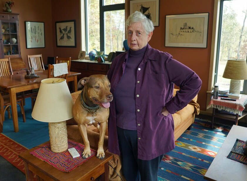 Annetta Cheek, with her dog, Keegan, at home in Hume, Va.