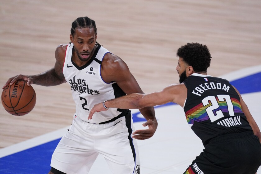 Clippers' Kawhi Leonard tries to get past Denver Nuggets' Jamal Murray.