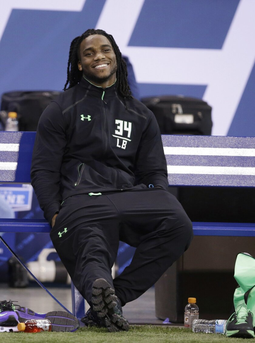FILE - In this Feb. 28, 2016 file photo, Notre Dame linebacker Jaylon Smith watches during drills at the NFL football scouting combine, in Indianapolis. Smith is sharing his journey with fans through a 360-degree virtual reality video. Smith was viewed as a certain top-10 NFL draft choice before he