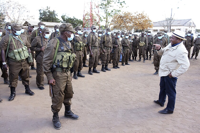 In this photo supplied by the Mozambican Presidency, President Filipe Nyusi, right, during a visit to his Defence and Security Force Troops in Northern Mozambique, Friday, July 9, 2021. Rwandan troops have joined the Mozambican forces to launch a major offensive against Islamic rebels in northern Mozambique as more troops arrive from South Africa and other neighboring countries to help battle the insurgency. (Photo Mozambique Presidency via AP)