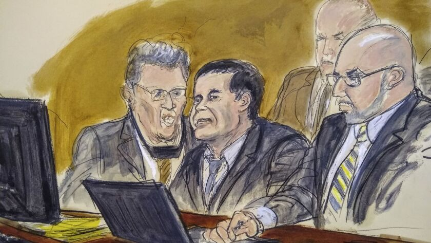 """In a courtroom drawing, Joaquin """"El Chapo"""" Guzman, center, listens to the judge's answer to a jury question Wednesday during his federal trial in Brooklyn, N.Y. Guzman sits with an interpreter and attorney Eduardo Balarezo, right. U.S. marshals sit behind them."""
