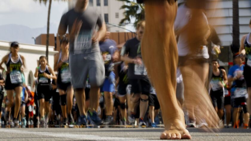 Runners make their way down Santa Monica Boulevard in Beverly Hills during the L.A. Marathon on March 18.