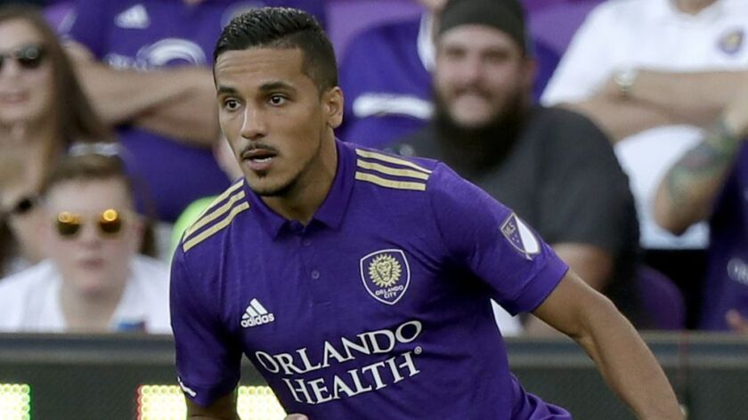 Orlando City's Mohamed El-Munir (13) moves the ball against the New England Revolution during the fi