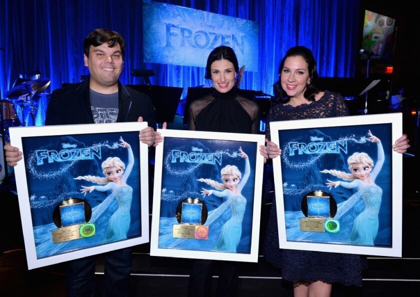 """Idina Menzel, center, with """"Frozen"""" songwriters Robert Lopez and Kristen Anderson-Lopez."""