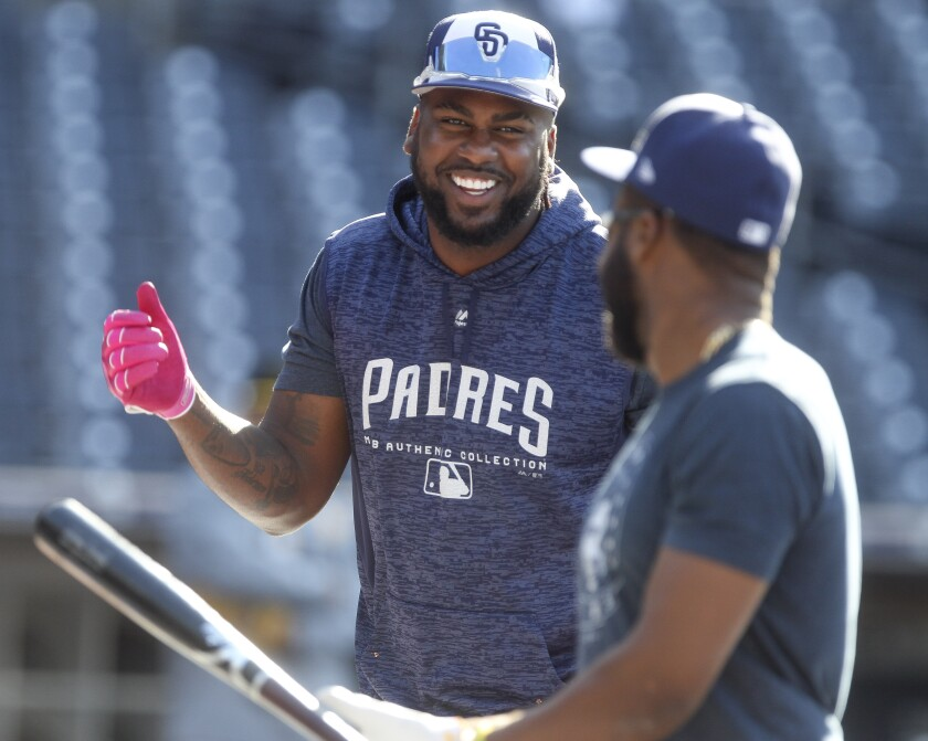 Franmil Reyes, left, shares a laugh with Manuel Margot before a game.